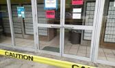Post Office front door with closed signs and caution tape