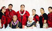 This  family photo shows the late Rev. Elder Dr. Pati Puia'i Vaeao sitting next to his wife of 47 years, Siafiafilelei Thompson Leasau, surrounded by family members