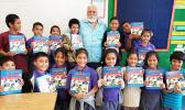 Rotary Club of Pago Pago vice president, Peter Tinitali presented dictionaries to the 3rd graders of Siliaga Elementary School.