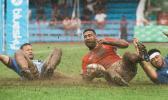 Cooper Vuna scores a try against Samoa on muddy field.