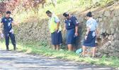 Samoa police beside the rock wall where the accident happened
