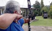 Samoan Prime Minister Tuilaepa Aiono Sailele Malielegaoi aiming to shoot an arrow