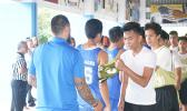 Samoana Sharks shake hands with Marist Crusaders after winning the Junior Varsity Basketball Division last Saturday morning at the Samoana High School Gymnasium in Utulei.  [photo: Ese Malala]