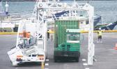 A container trailer truck goes through the M60 container scanner equipment around 7a.m. on Monday, Apr. 3, when the scanner operation as well as the scanner fee, went into effect, at the main dock of the Port of Pago Pago. Customs officials says some 30-plus containers were scanned on Monday. [photo: Fili Sagapolutele]