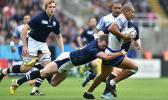 Samoa's Paul Perez (right) is tackled by Scotland's Stuart Hogg
