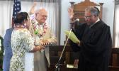 Chief Associate Judge Mamea Sala Jr., administers the oath of office to Logoai Siaki Logoai