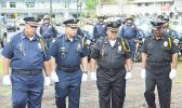 Seniors police officers parading during Police Week celebration earlier this year at Malaeoletalu in Fagatogo. DPS has a new established unit - the Training Division - which is set up to provide training for local police officers. See story for full details.  [photo: AF]
