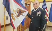 SFC Samasoni Lele'a with the American Samoa flag
