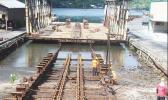 Ronald Reagan Shipyard employees working on repairs to the front portion of the 3,000-ton slipway last year.