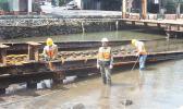 Three Ronald Reagan Shipyard employees, carrying out repair work