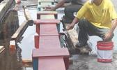 Ronald Reagan Shipyard workers painting the new beams