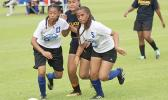 Two Samoana players defend against a Fa'asao-Marist opponent