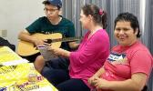 Special needs kids with a parent enjoying making music.
