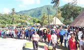 "In the sweltering heat, hundreds of employees from StarKist Samoa and Talofa Systems were at the Suigaula ole Atuvasa Beach Park this past Saturday to pick up their care packages and other items donated by ""Love Thy Neighbor"" and other local businesses. [photo: courtesy]"