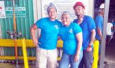 Three StarKist employees dressed in blue pose for the camera.