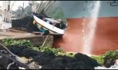 A screen shot of a video taken by Frank Barron of the incident that happened last Thursday afternoon, where the oil tanker, CSC Brave, crashed into the stern (back) of a purse seiner vessel docked at the main-dock area where fishing nets are repaired, near the Fuel Dock. Samoa News was told at the time that the incident looked like it had been caused by government tugboats, however, Port Administration says no, it was caused by the tanker's engine problems. US Coast Guard's investigation of the incident is