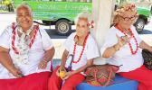 Three senior citizens at bus stop