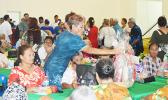 Faauifono Vaitautolu, giving out gift baskets to senior citizens