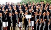 the Samoana Sharks — pictured with their choir director, Pati Pati (left) and school principal Rod Atafua (right)