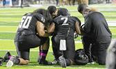 Justus Tavai, Djuan Mathews, Gene Pryor, Kohl Levao, and Solo Vaipulu kneedling in prayer