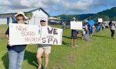 SPA teachers on strike holding signs