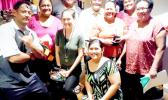Some of American Samoa's in-service teachers gather around Dr. Larry Purcell (back row, in white shirt)