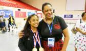 High school weightlifter Olivia Selemaia with Beatrice Faumuina