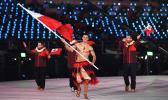 Tonga's flagbearer Pita Taufatofua leads his country's delegation. [Photo: AFP via RNZI]