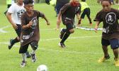 A Vaiala Tongan player of the Boys 10-12 division in action against Ilaoa & To'omata