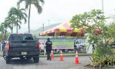 Road block at Tradewinds Hotel during quarantine of first repat flight.