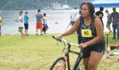 Zeniah — a 19-year-old female from Pago Pago, who placed 2nd in the Sprint Category for her age group hurries with her bike during the triathlon that was held last week Saturday at the Utulei Beach. [photo: Ese Malala]
