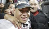 Alabama's Tua Tagovailoa celebrates with his parents Galu and Diane after overtime of the NCAA college football playoff championship game against Georgia Monday, Jan. 8, 2018, in Atlanta. Alabama won 26-23. (AP Photo/David Goldman)