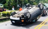 SUV upside down in the road