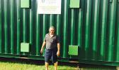 In this Samoa News file photo, Su'a Alexander Eli Jennings outside of the retrofitted freight container back in October 2015, where raw ulu will be processed and dried to be milled into gluten free, low glycemic index flour. The container operates on solar panels to provide renewable energy for the retrofitted container.   [Photo: JL]