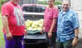 Dream Builders Agriculture Products owner, Su'a Alexander Eli Jennings (far right) pictured with a family who last week delivered a truck load of breadfruit