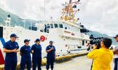Members of the Coast Guard Cutter Joseph Gerczak and a Coast Guard recruiter give interviews to television reporters in the Port of Pago Pago