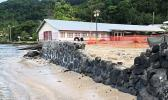 Rock wall going up on Utulei Beach behind DDW