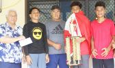 Members of the Vaiala Tongan Boys 13-15 team receive their championship trophy