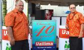 "Latu Kupu and Afa Young showing off ""Vailima, Samoa's Own Beer"" special signage"