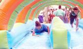 The water slide bounce was a big hit on Saturday during the the 2nd Annual MASI Easter Bash at le Suigaula a le Atuvasa in Utulei. [Photo: EM]