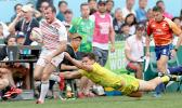 At the HSBC World Rugby Sevens Series XVIII in Hong Kong on April 8, 2017 Tom Bowen of England outruns Australian defender to score Englands second try.  Australia prevailed 12-10 to win Pool A with 9 points.   Australia will face Argentina in the Cup quarter finals.  England will play USA.