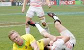 At the HSBC World Rugby Sevens Series XVIII in Hong Kong on April 8, 2017 Australia's Henry Hutchinson touches down against England to score Australia's first try.  Argentina beat England 12-10 to win Pool A.  Australia will play Argentina in the Cup quarter final.  England will play against USA.