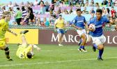 Lafaele Tuliuvaa scores Samoa's second try in Hong Kong against Australia.  Australia, the top seed in pool A, narrowly beat Samoa 22-19.  Samoa now faces England and Korea on Saturday in their other two pool play matches at the 2017 Cathay Pacific/HSBC Hong Kong Sevens.