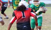 Misa Paiau of the JPS Lions is greeted by Vaouli of the JPS Vikings
