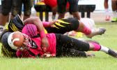John Muliaga of Faga'itua watches the live ball helplessly after being rocked hard by Branson Pualau in the second quarter of the match – causing a fumble that carried Nu'uuli into Vikings territory for another threatening offensive drive.  [photo: TG]