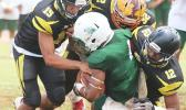 Leone Lions' Joshua Taani being swallowed in the backfield by